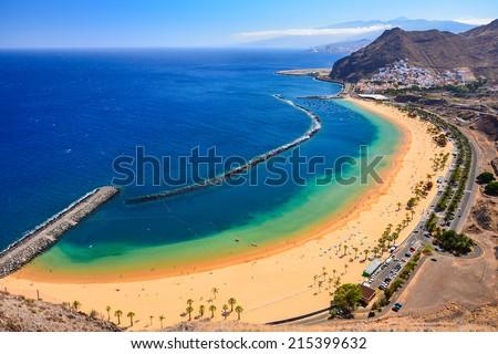 View of famous beach and ocean lagoon Playa de las Teresitas,Tenerife, Canary islands, Spain - stock photo