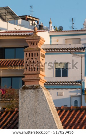 View of Ferragudo village chimney detail located in Portugal.