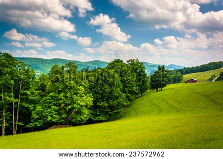 View of fields and distant mountains in the rural Potomac Highlands of West Virginia. - stock photo