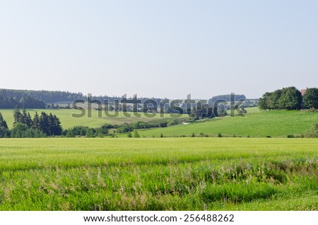 View of fields and forests of Prince Edward Island - stock photo