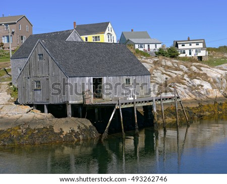 View of fishing shed and houses in the quaint fishing village of Peggy's Cove near Halifax, Nova Scotia, Canada