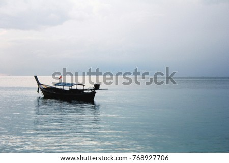 View of floating boat in sunset time at Lepe island, Satun, Thailand.