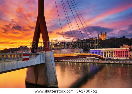 View of footbridge on Saone river at sunset, Lyon, France. - stock photo