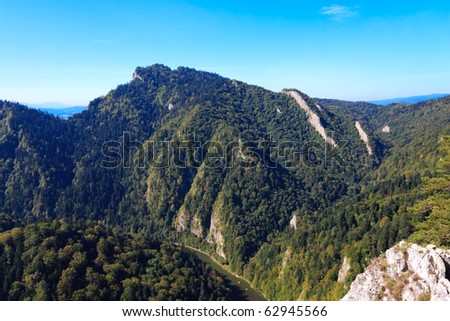 View of forest covered mountains and Dunajec river below - stock photo