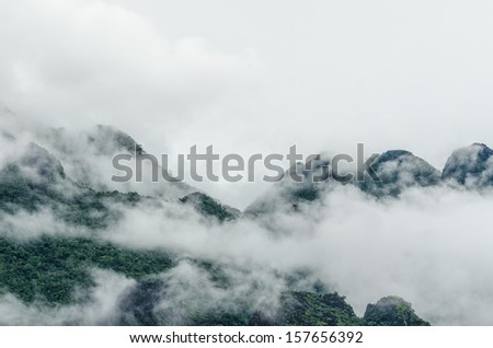 View of forest on Morning Mist at Tropical Mountain Range after rain fall, Laos