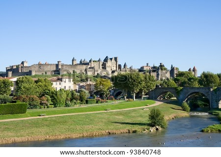 View of fortress Carcassonne (France, Languedoc), river Aude and Old bridge - stock photo