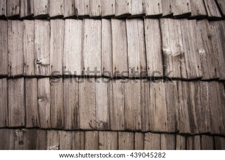 View of four rows of wooden sawn rough boards with nails