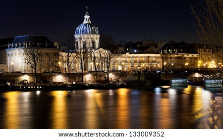 view of French Academy above river in Paris at night - stock photo