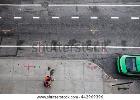 View of from above of urban street in New York City Manhattan with pedestrians and car