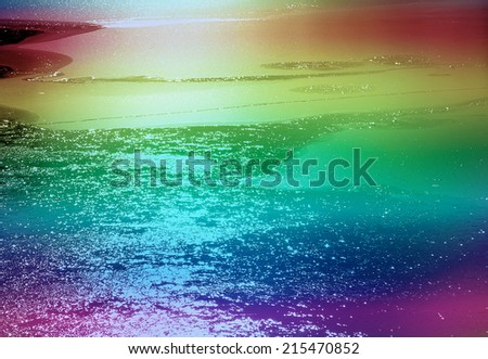 View of frozen water on lake with added rainbow colors - stock photo