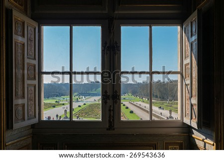 View of garden from window inside Vaux le Vicomte Castle, baroque French Palace located in Maincy, near Paris. Constructed from 1658 to 1661 for Nicolas Fouquet. - stock photo