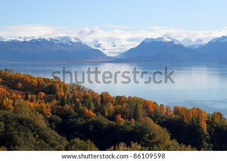 View of glaciers and mountains with the fresh snow across the Kachemak bay, Alaska with bright fall colors. - stock photo