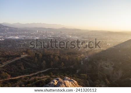 View of Glendale, California in misty morning light from Bee Rock in Los Angeles's Griffith Park. - stock photo