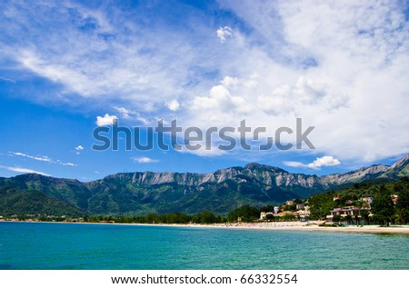 view of golden beach and the mountains behind on the greek island of thassos - stock photo