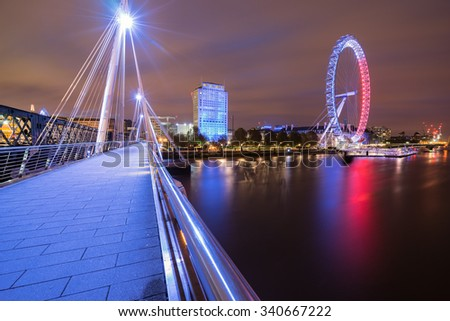 View of Golden Jubilee Bridge at Sunrise with London Eye in French flag colors in London, England - stock photo