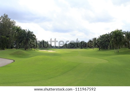 view of golf course from tee box - stock photo