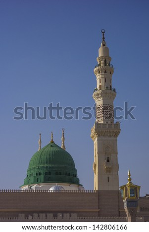 View of green dome of Nabawi Mosque in the morning during afternoon in Al Madinah, Saudi Arabia. - stock photo