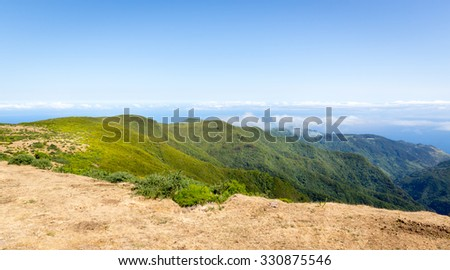 View of green mountains in the sky landscape, Portugal, Madeira - stock photo