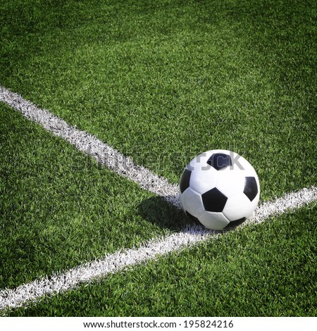 view of green striped football field with soccer ball