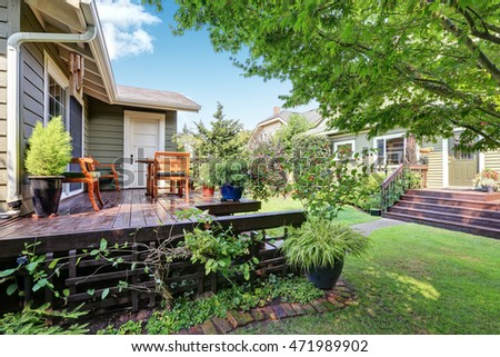 View of guest house with wooden deck and nicely trimmed garden. Northwest, USA