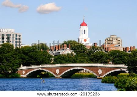 View of Harvard University and pedestrian bridge on Charles River, Cambridge, Massachusetts - stock photo