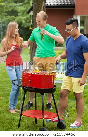 View of having fun on a barbecue - stock photo