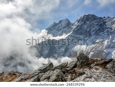 View of Himalayan peaks from slope of Sounder peak (near Thame village) in the clouds - Everest region, Nepal - stock photo