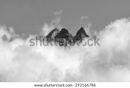 View of himalayan peaks in fog from Thame - Nepal (black and white) - stock photo