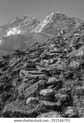 View of himalayan peaks in mist from the Sunder peak - Nepal (black and white) - stock photo