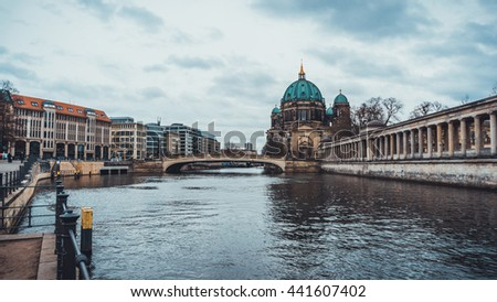 View of Historical Berlin Cathedral and Bridge Crossing River Spree to Museum Island as seen from Mainland in Berlin, Germany on Overcast Day
