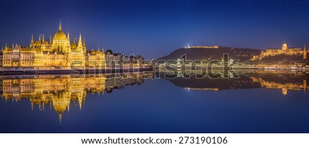 View of hungarian Parliament building and Liberty Statue at night in Budapest, Hungary - stock photo