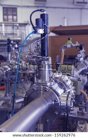 View of Important electronic and mechanical parts of Mass spectrometer in ION Accelerator command room, CNC machined parts, selective focus,  tilt shift lens,  industrial blue toned   - stock photo