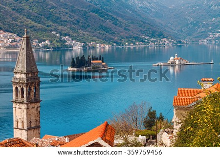 View of islets of St. George and Our Lady of the Rocks through Perast, Montenegro. - stock photo