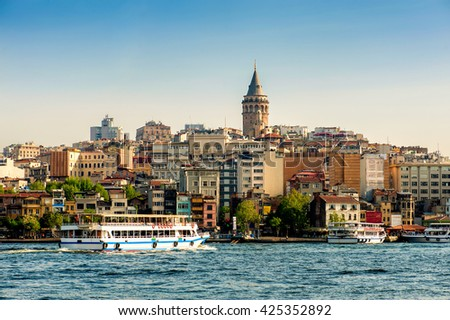 View of Istanbul with Galata Tower and vapur,  Istanbul, Turkey.