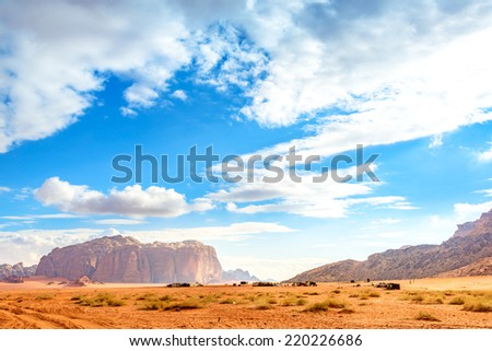 View of Jordanian desert in Wadi Rum, Jordan.  It is known as The Valley of the Moon and a UNESCO World Heritage Site. - stock photo