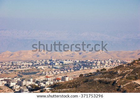 View of Judaean Desert and Maale Adumim town in haze from Mount Scopus in Jerusalem (Israel). - stock photo