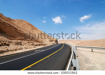 View of Judean desert landscape. Highway to the Dead Sea. - stock photo