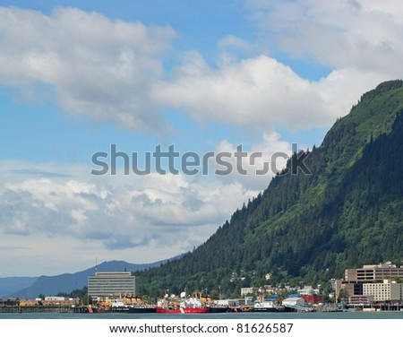 View of Juneau Alaska on a sunny summer day with clouds - stock photo