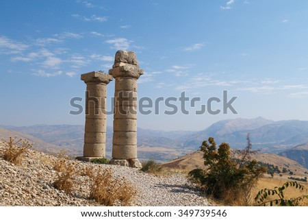 View of Karakus Tumulus, ancient historical and blessed area of Nemrut National Park, on clear blue sky background.