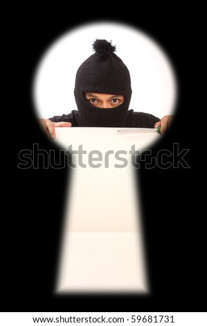 View of key hole, thief inside. - stock photo