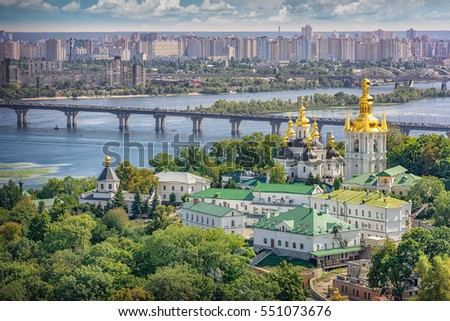 View of Kiev (Ukraine) with caves monastery and saint-sophia cathedral, dnjepr river with a bridge and the city of Kyiv in the background