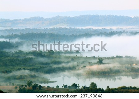 View of Koa Kor valley community in morning mist at Petchaboon province Thailand - stock photo