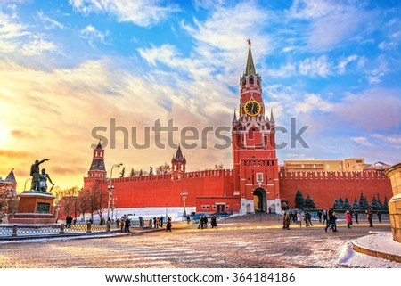 View of Kremlin and Spassky Tower with chimes on Red square at sunset winter in Moscow, Russia - stock photo