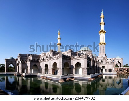 View of Kuala Lumpur  Federal Mosque with blue sky . Image has grain or blurry or noise and soft focus when view at full resolution. (Shallow DOF, slight motion blur) - stock photo