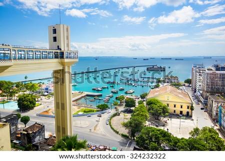 View of Lacerda Elevator and All Saints Bay (Baia de Todos os Santos) in Salvador, Bahia, Brazil. - stock photo