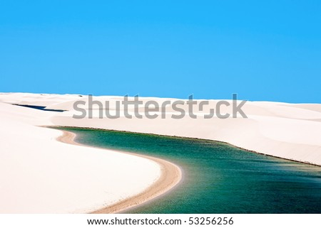 view of lagoa azul in desert white sand dunes of the Lencois Maranheses National Park in brazil - stock photo
