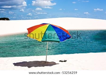 view of lagoa azul in desert white sand dunes of the Lencois Maranheses National Park in brazil - stock photo