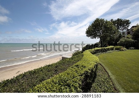 View of lake and beach from back yard - stock photo