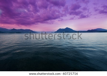 View of Lake Maggiore from the shore at sunset, a famous tourist Italian