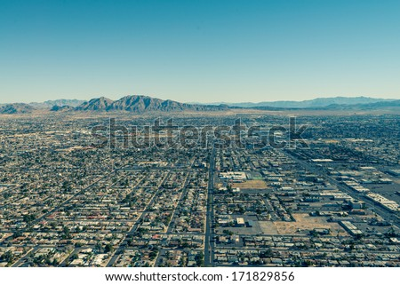 View of Las Vegas and its surrounding urban and mountains from a high vantage point - stock photo